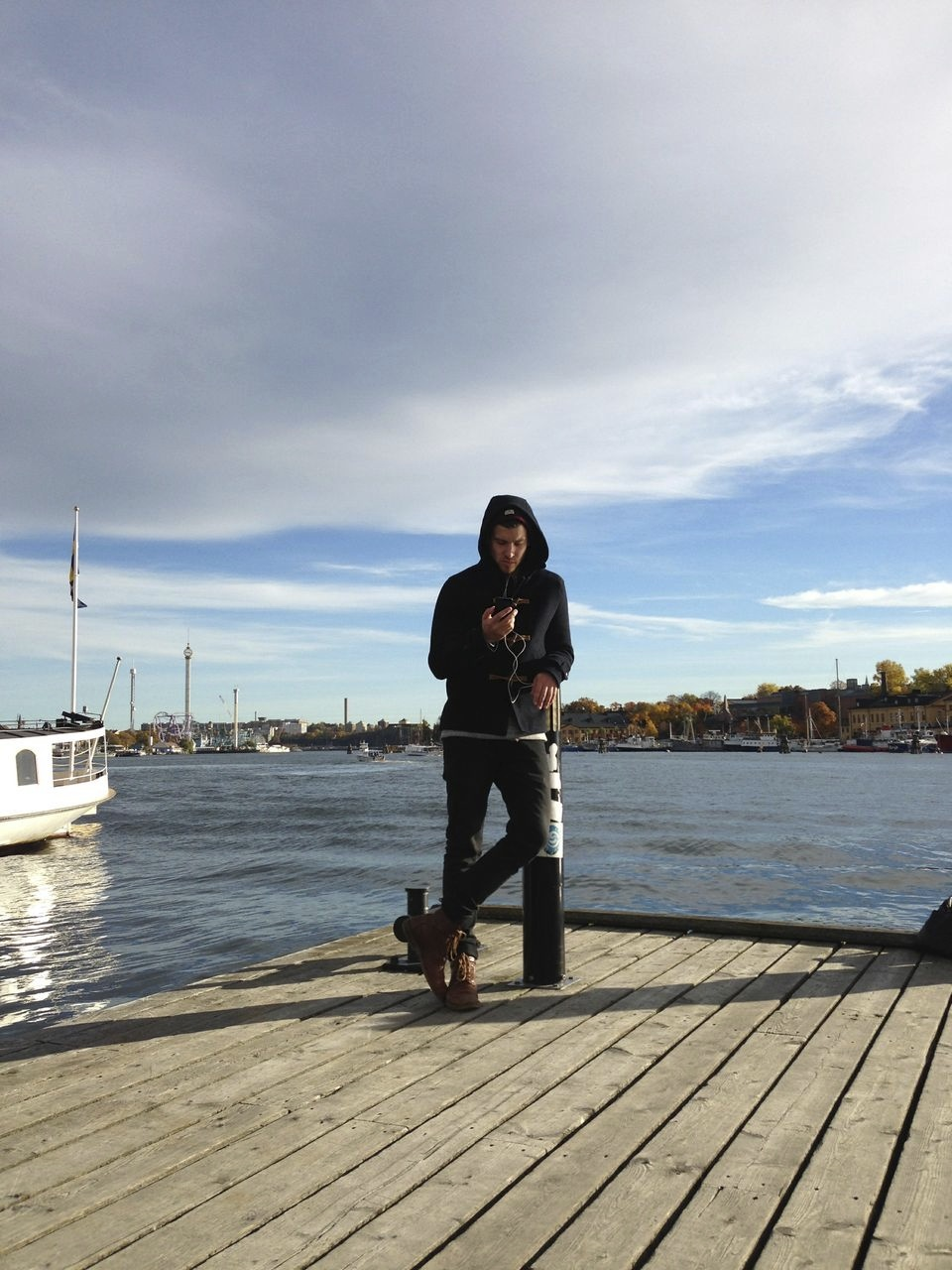 posing like a pro at strandvägen after a long city walk already a little nervous because of the big game that night