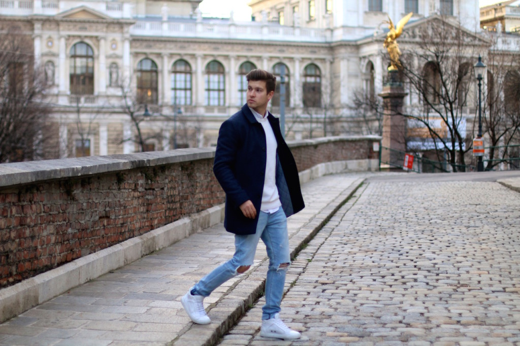 Menswear blogger showing outfit of the day featuring a blue winter coat by Selected homme ripped jeans by Neuw and ETQ sneakers 2
