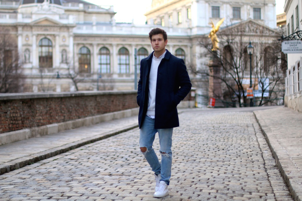 Menswear blogger showing outfit of the day featuring a blue winter coat by Selected homme ripped jeans by Neuw and ETQ sneakers 3