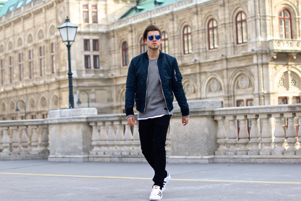 menswear blogger meanwhileinawesometown wearing schott nyc bomber jacket and blkdnm jeans from aboutyoude in front of Vienna Opera