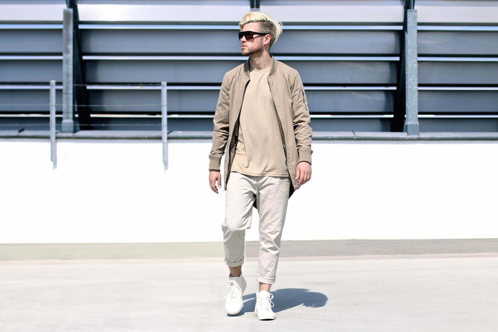 outfit combining neutral colors bomber parka chinos